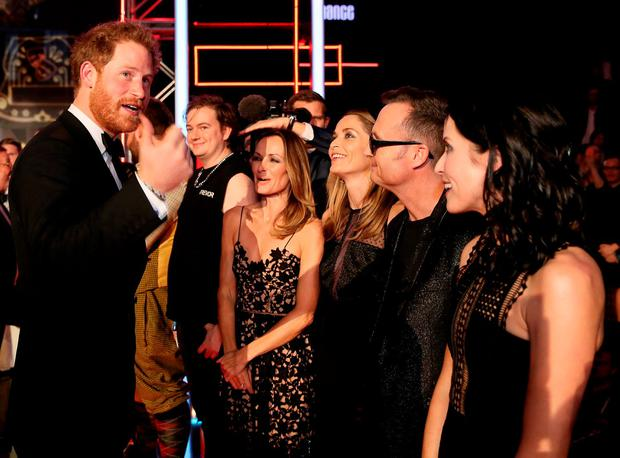 Britain's Prince Harry greets members of the The Corrs after the Royal Variety Performance at the Albert Hall in London, November 13, 2015. REUTERS/Paul Hackett