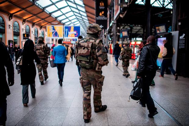 A French soldier patrols at Gare Saint Lazare train station in Paris, Saturday, Nov. 15, 2015. French President Francois Hollande vowed to attack Islamic State without mercy as the jihadist group admitted responsibility Saturday for orchestrating the deadliest attacks inflicted on France since World War II. (AP Photo/Kamil Zihnioglu)