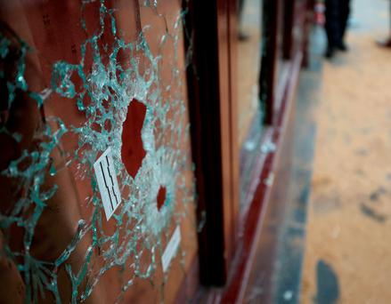 Damaged caused to the Le Carillon bar, Paris, one of the venues for the attacks in the French capital Credit: Steve Parsons/PA Wire