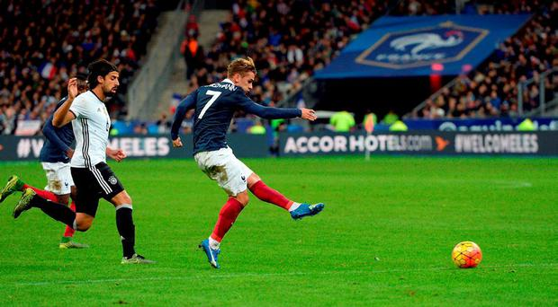 French midfielder Antoine Griezmann (C) in action during last night's friendly international at the Stade de France which was targeted by terrorists