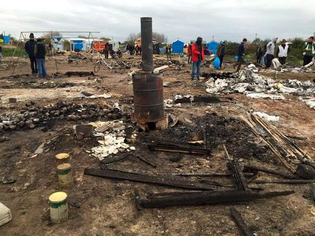 The aftermath of the fire in Calais Credit: Tomasz Sekielski\Twitter