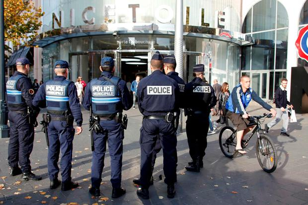 French national and municipal police stand guard outside a commercial center in NIce, France, November 14, 2015, the day after a series of deadly attacks in Paris. REUTERS/Eric Gaillard