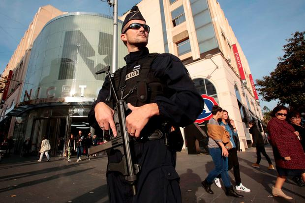 A French policeman stands guard outside a commercial center in NIce, France, November 14, 2015, the day after a series of deadly attacks in Paris. REUTERS/Eric Gaillard