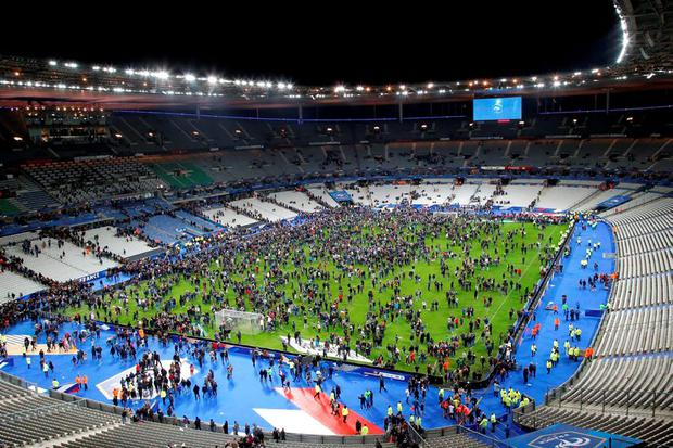 Spectators invade the pitch of the Stade de France stadium after the international friendly between France against Germany