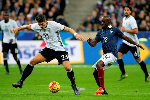 Germany's Mario Gomez in action with France's Lassana Diarra during the friendly at the Stade de France last night. REUTERS/Gonzalo Fuentes