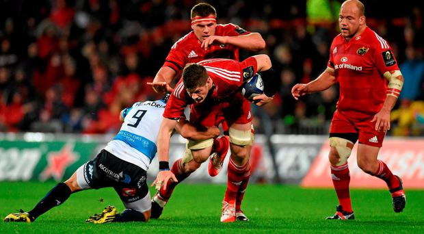 14 November 2015; Jack O'Donoghue, Munster, supported by team-mates CJ Stander and BJ Botha, is tackled by Edoardo Gori, Benetton Treviso. European Rugby Champions Cup, Pool 4, Round 1, Munster v Benetton Treviso. Thomond Park, Limerick. Picture credit: Diarmuid Greene / SPORTSFILE