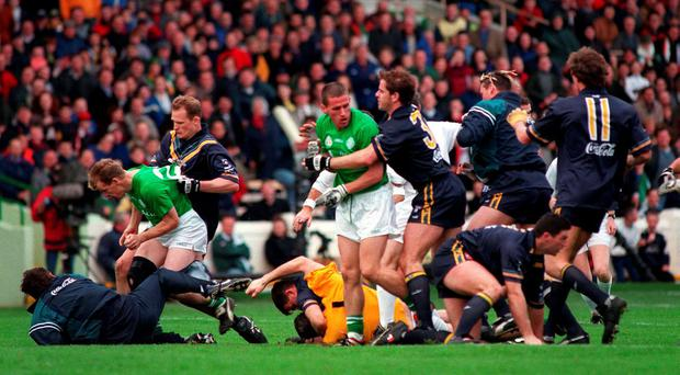Ireland and Australia players get involved in a dust-up in 1998 in yet another extremely physical encounter