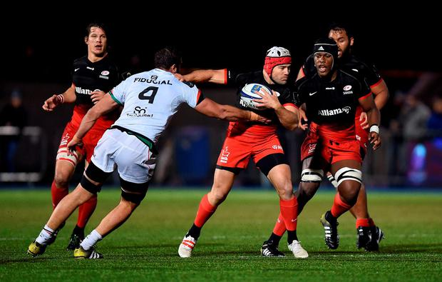 Saracens' Schalk Brits (centre) hands off Toulouse's Yoann Maestri during the European Champions Cup, pool one match