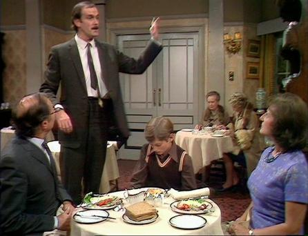 Disgruntled: restaurants are beginning to adopt the smug approach, personified by Basil Fawlty