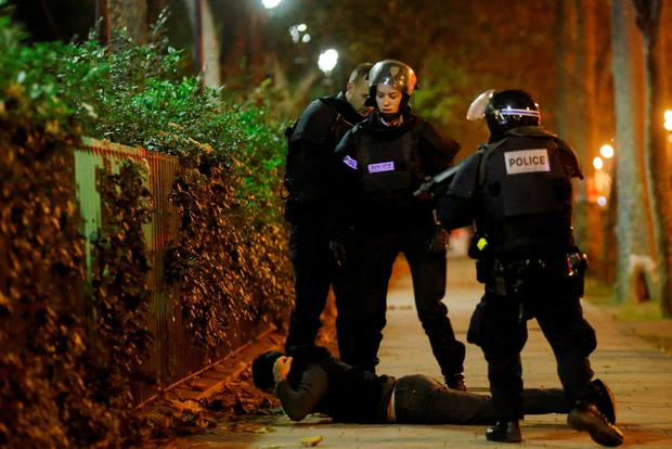 A man lies on the ground as French police check his identity near the Bataclan concert hall following fatal shootings in Paris, France Credit: Christian Hartmann (REUTERS)