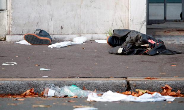 Clothes and bandages are seen left in the street near the Bataclan concert hall the morning after a series of deadly attacks in Paris Credit: Charles Platiau (REUTERS)