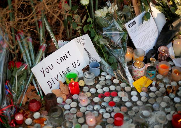 Flowers and tributes are left close to the Bataclan concert hall where Omar Ismail Mostefai's detached finger was found Credit: Steve Parsons/PA Wire