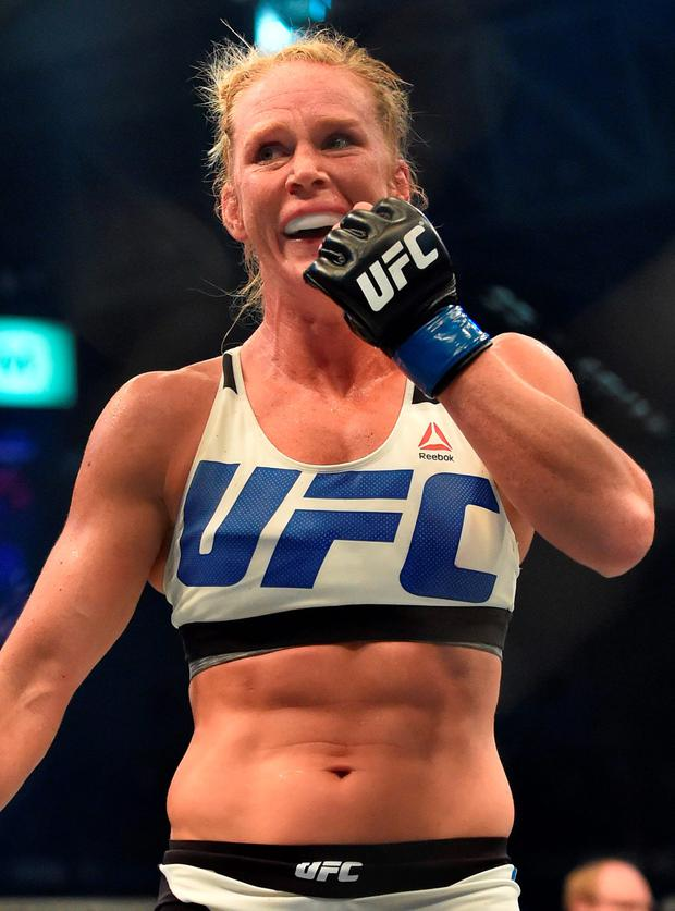 Holly Holm of the US celebrates after winning the UFC title fight against compatriot Ronda Rousey in Melbourne on November 15, 2015. RESTRICTED TO EDITORIAL USE NO ADVERTISING USE NO PROMOTIONAL USE NO MERCHANDISING USE. AFP PHOTO/Paul CROCKPAUL CROCK/AFP/Getty Images