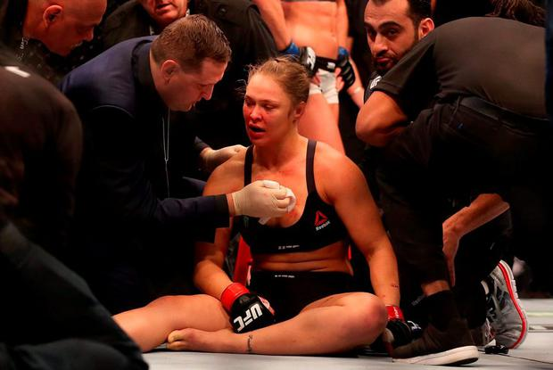 Ronda Rousey of the United States receives medical treatment after being defeated by Holly Holm of the United States in their UFC women's bantamweight championship bout during the UFC 193 event at Etihad Stadium in Melbourne