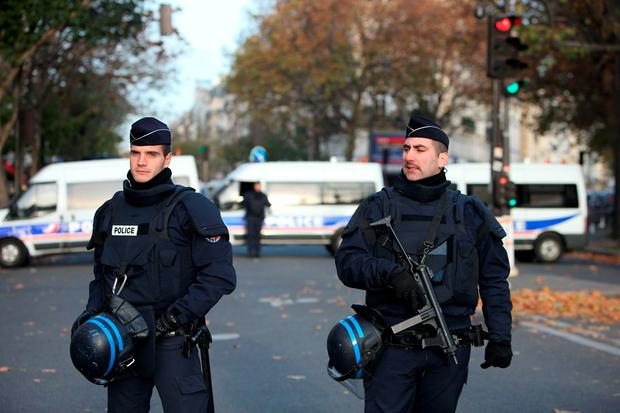 Police activity by the Bataclan concert hall, where the Syrian passport was found Credit: Steve Parsons (PA Wire)