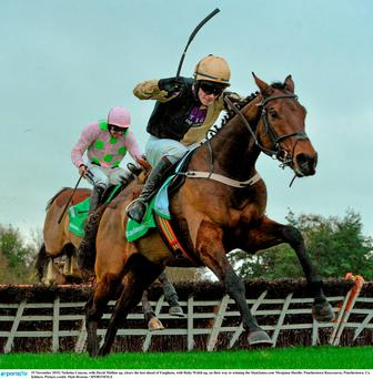 15 November 2015; Nicholas Canyon, with David Mullins up, clears the last ahead of Faugheen, with Ruby Walsh up, on their way to winning the StanJames.com Morgiana Hurdle. Punchestown Racecourse, Punchestown, Co. Kildare. Picture credit: Matt Browne / SPORTSFILE