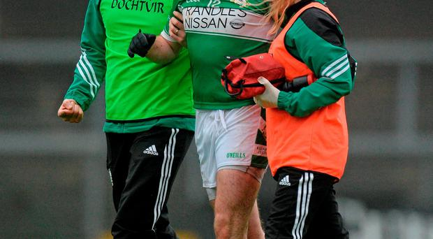 15 November 2015; Kevin Breen, Killarney Legion, leaves the field wafter picking up a blood injury. AIB Munster GAA Senior Club Football Championship, Semi-Final, Nemo Rangers v Killarney Legion. Páirc Uí Rinn, Cork. Picture credit: Piaras Ó Mídheach / SPORTSFILE