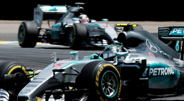 Mercedes driver Nico Rosberg, of Germany, leads followed by teammate Lewis Hamilton, of Britain, during the Formula One Brazilian Grand Prix at the Interlagos race track in Sao Paulo, Brazil, Sunday, Nov. 15, 2015. (AP Photo/Andre Penner)