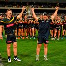 Australia captain Joel Selwood and coach Alastair Clarkson are presented with the Cormac McAnallen Cup after victory in last year's International Rules Series