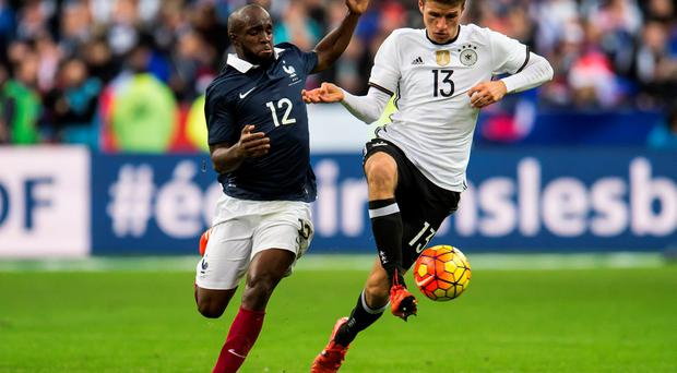 Lassana Diarra battles it out with Mario Gomez during last Friday's friendly in Paris