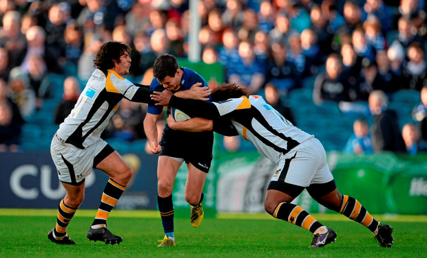 Jonathan Sexton, Leinster, is tackled by Ben Jacobs, left, and Ashley Johnson, Wasps
