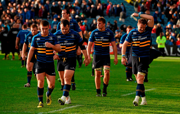Dejected Leinster players (from left) Luke McGrath, Cian Healy, Jordi Murphy, and Jamie Heaslip troop off the pitch after their humiliating defeat to Wasps
