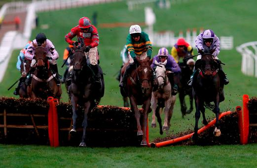 The Charles Byrnes-trained Leave At Dawn, ridden by Barry Geraghty (centre), jumps the last on the way to winning the Intermediate Handicap Hurdle at Cheltenham on Saturday for owner JP McManus