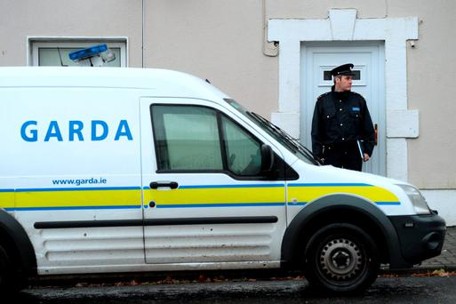 15 Nov 2015; General view of garda outside house on main street, Ballynacargy, Co. Westmeath. Picture: Caroline Quinn