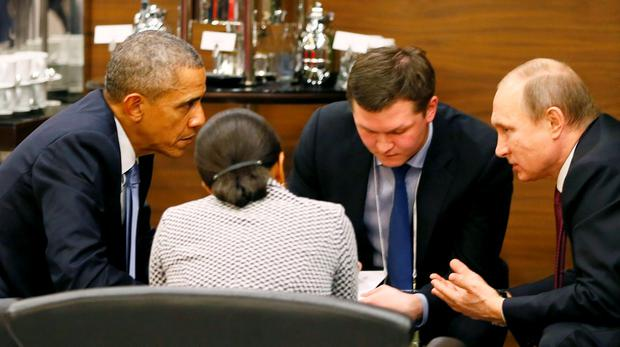 U.S. President Barack Obama (L) talks with Russian President Vladimir Putin (R) and U.S. security advisor Susan Rice (2nd L) prior to the opening session of the Group of 20 (G20) Leaders summit summit in the Mediterranean resort city of Antalya, Turkey November 15, 2015. Man at 2nd R is unidentified. REUTERS/Cem Oksuz/Pool