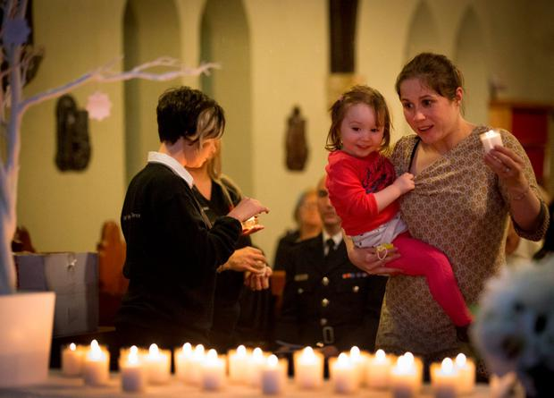 Teresa Corrigan with her daughter Kiera (2), who lost her brother Kieran 10 years ago in Bantry at the memorial service in St Finian's Lutheran Church on Adelaide Road, Ranelagh, to mark 'World Day of Remembrance for Road Traffic Victims