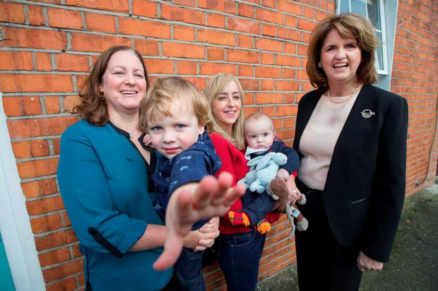 Joan Burton, right, with Orla and Nicola Malone Leonard and their sons Harry (3) and James (six months)