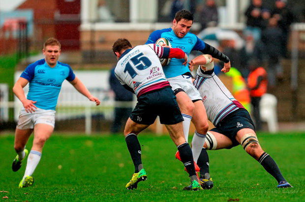 Billy Dardis, Leinster A, is tackled by Sean Scanlon and Max Argyle, Rotherham Titans