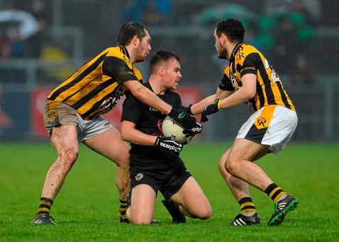 Kilcoo's Darragh O'Hanlon takes on Crossmaglen's Johnny Hanratty and Aaron Cunningham during the AIB Ulster GAA Senior Club Football Championship, Semi-Final