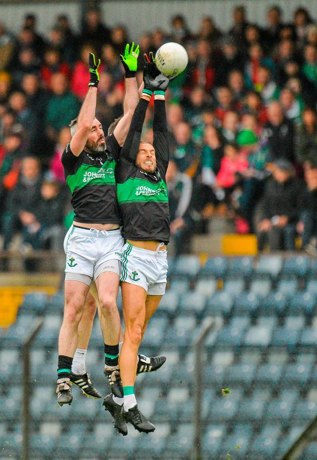 Michael Dorgan, right, and David Niblock, Nemo Rangers, contest a kick-out with Legion's Shaun Keane during their Munster SFC semi-final