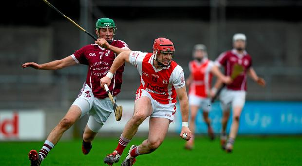 Cuala's David Treacy in action against Clara's Shane Prendergast