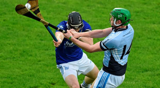 Shane Dowling is blocked down by Stephen Lillis of Thurles Sarsfields
