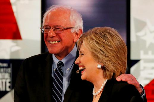 Hillary Clinton shares a laugh with fellow candidate Senator Bernie Sanders after the second Democratic debate in Des Moines, Iowa