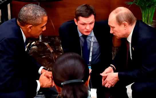 US President Barack Obama speaks to Russian President Vladimir Putin in Antalya, Turkey, ahead of the G20 summit