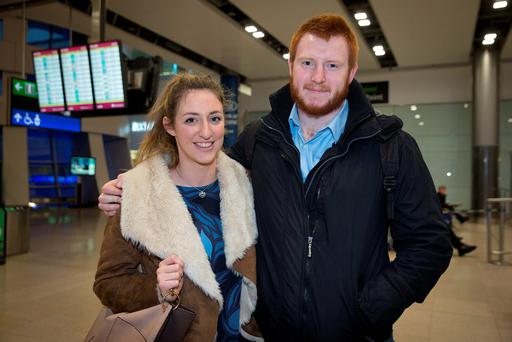 Chloe Breen and Diarmaid Hickey arrive at Dublin Airport