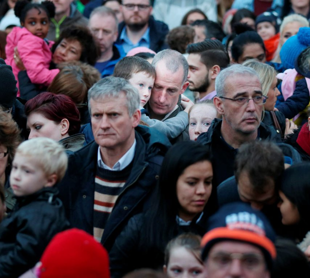 NO REPRO FEE. 15/11/2015. A man holds his son during a minute silence on Grafton Street for the victims of the Paris attack. Thousends of people turned out for the turning of the Christmas lights on Grafton Dublin a partnership between DublinTown, Dublin City Council. Photo: Leon Farrell/Photocall Ireland.