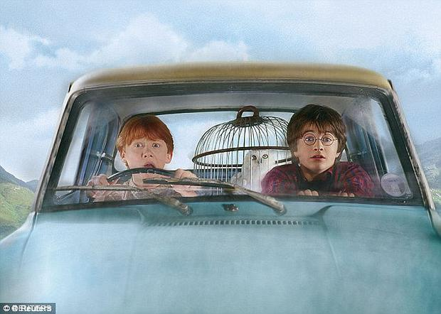 Harry Potter and Ron Weasley fly through the skies in the wizard's magic car