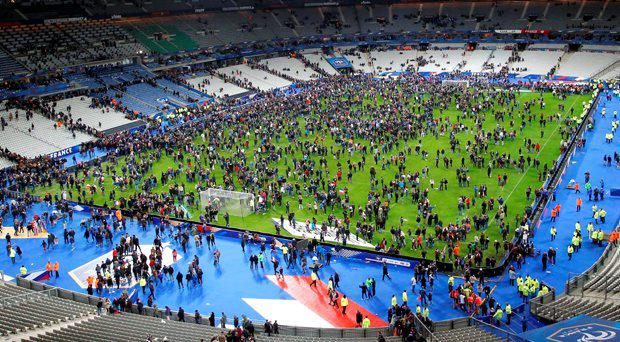 Spectators invaded the pitch of the Stade de France stadium after the international friendly soccer France against Germany on November 13 after explosions outside the ground