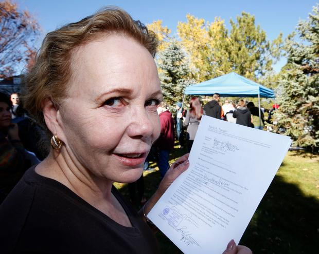SALT LAKE CITY, UT - NOVEMBER14: Patricia Peterson hold her letter of resignations from the Church of Jesus Christ of Latter-Day Saints in response to a recent change in church policy towards married LGBT same sex couples and their children on November 14, 2015 in Salt Lake City, Utah. A little over a week ago the Mormon church made a change in their official handbook of instructions requiring a disciplinary council and possible excommunication for same sex couples and banning the blessing and baptism of their children into the church. (Photo by George Frey/Getty Images)