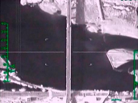 A frame grab taken from a footage released by Russia's Defence Ministry November 5, 2015, shows what Russia says is a target site shortly before airstrikes carried out by the Russian air force on a bridge under militants' control near Raqqa, Syria.Reuters/Ministry of Defence of the Russian Federation