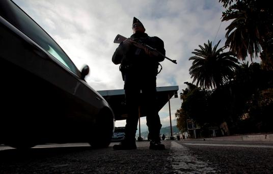 An armed French police officer stands guard at the Franco-Italian border to check vehicles. The Isil attacks in Paris have proved that no country and no individual are immune to its mindless terror. REUTERS/Eric Gaillard
