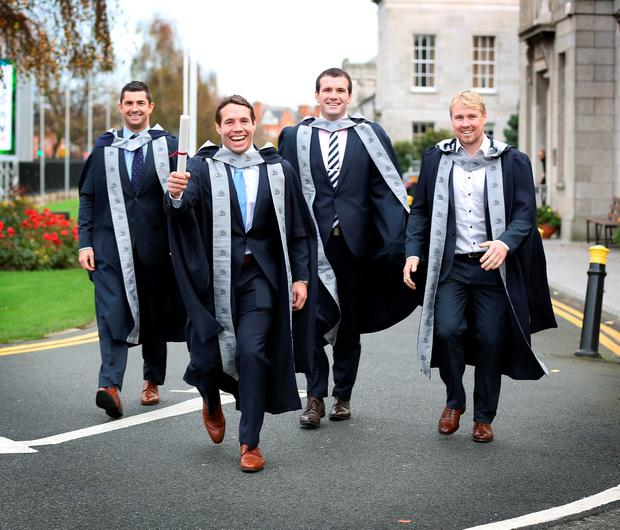 Rob Kearney, Isaac Boss, Shane Jennings and Fionn Carr at the DBS graduation in the RDS. Photo: Robbie Reynolds