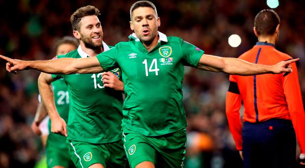 Ireland's striker Jonathan Walters (C) celebrates after scoring his team's first goal from a penalty