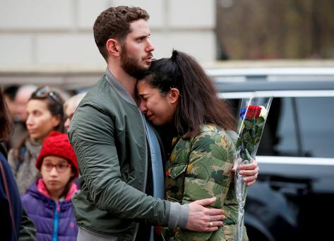 A couple in Paris mourn the victims of the terrorist attacks