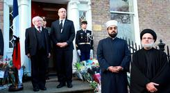 President Michael D Higgins pictured with The French Ambassador to Ireland H E Jean-Pierre Thebault, Shaykh Muhammad Umar Al-Qadri, Imam of Blanchardstown Mosque and CEO of the Irish Muslim Peace & Integration Council and Ali Al Saleh, Imam Miltown Mosque, during the minutes silence outside The French Embassy on Dublins Merrion Square, for the victims of the Paris terrorist attack. Picture Credit Frank Mc Grath