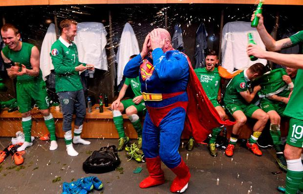 Republic of Ireland equipment officer Dick Redmond and players celebrate in the dressingroom after the game. UEFA EURO 2016 Championship Qualifier, Play-off, 2nd Leg, Republic of Ireland v Bosnia and Herzegovina. Aviva Stadium, Lansdowne Road, Dublin. Picture credit: David Maher / SPORTSFILE